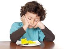 乏味儿童吃 库存图片