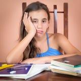 乏味和疲倦的西班牙学生 免版税库存图片
