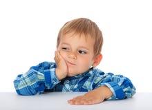 乏味小男孩 免版税库存照片