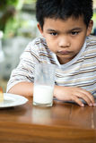 乏味年轻亚裔男孩 免版税图库摄影