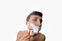 乐趣有在白色背景的刮脸的fisheye观点的年轻人 图库摄影