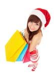 乐趣有程序包的圣诞老人妇女 免版税图库摄影