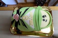 乐高Ninjago劳埃德启发了与第6和名字'Antek的生日蛋糕 库存照片