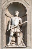 乔凡尼dalle在乌菲齐画廊之外的班德Nere雕象在佛罗伦萨 免版税库存照片