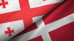 乔治亚和丹麦两旗子纺织品布料,织品纹理 库存例证