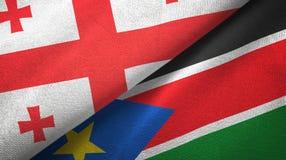 乔治亚和南苏丹两旗子纺织品布料,织品纹理 皇族释放例证
