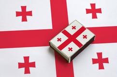 乔治亚旗子在一面大旗子说谎的火柴盒被生动描述 免版税库存照片