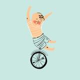 乘坐单轮脚踏车的男孩 库存照片