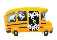 乘坐在校车的孩子 免版税库存照片
