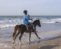 乘坐在海滩 免版税图库摄影