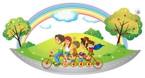 乘坐在自行车的孩子 皇族释放例证