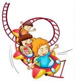 乘坐在过山车的三个孩子 库存照片