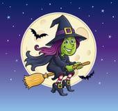 乘坐有月亮的女孩巫婆一把笤帚 库存图片