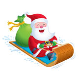 乘坐木雪橇雪雪撬的圣诞老人 免版税图库摄影