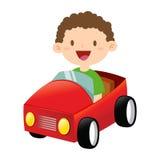 乘坐玩具汽车的愉快的小男孩 免版税库存照片
