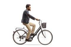 乘坐自行车的年轻人 库存照片