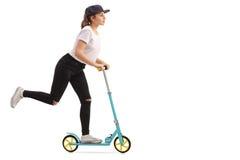 乘坐滑行车的女孩 图库摄影