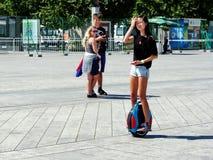 乘坐Segway的一个女孩在北京国民奥林匹克公园 免版税图库摄影
