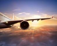 乘客在云彩上的飞机飞行特写镜头  库存照片