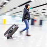 乘客在北京机场,行动迷离 免版税图库摄影