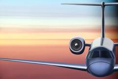 乘客在日出背景的班机飞行 库存图片