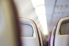 乘客座位,飞机旅行概念内部  免版税库存图片