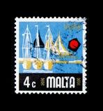 乘快艇小游艇船坞,马耳他serie的方面,大约1973年 免版税库存照片