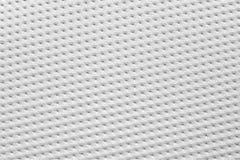乙烯基纸纹理穿孔了板料白色颜色 免版税库存图片