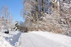 乡下公路雪 免版税图库摄影