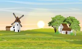 乡下在夏天 磨房、谷仓和房子有庭院的 皇族释放例证