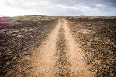 乡下沙漠土路 图库摄影
