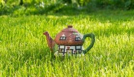乡村模式茶的罐 免版税库存图片