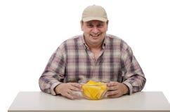 乡民显示水多的黄色西瓜 免版税库存图片