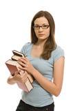 书俏丽的妇女年轻人 免版税库存图片