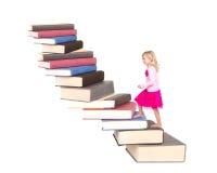 书儿童上升的楼梯  库存照片