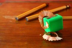 书写在磨削器和两支unsharpened铅笔 免版税库存照片