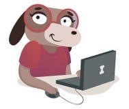 书呆子使用计算机的狗女孩 图库摄影