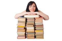 书堆积微笑的妇女年轻人 免版税库存图片