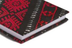 书夹子金黄笔记本红色部分磁带文字 免版税图库摄影