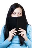 书女孩认为 免版税库存图片