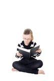 书女孩读取年轻人 图库摄影
