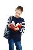 书女孩读取甜点 库存图片