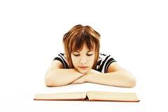 书服务台女孩读取坐少年 免版税库存图片