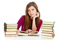 书服务台女孩读取开会 图库摄影