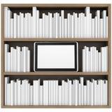 书架和片剂个人计算机 免版税库存图片
