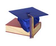 书毕业生帽子 免版税库存照片