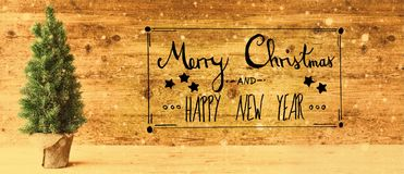 书法、圣诞快乐和新年快乐,减速火箭的树,雪花 免版税库存图片