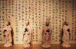 书法和雕象 库存图片