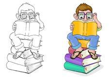 书男孩读取年轻人 免版税库存照片