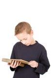 书男孩读取年轻人 免版税库存图片